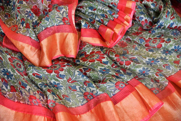 Escape the monotony in our green floral handprinted kota silk saree. The serene sari with a red zari embroidery contrast on the border is an absolute bliss. Style this sari with a red zari detailed blouse. Shop handcrafted silk sarees, kanjeevaram silk saris, printed sarees online or visit Pure Elegance store, USA. -details