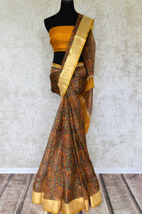Invest in handcrafted authentic zari kota silk traditional sari this season to look your best. This yellow colored traditional saree with handprinted motifs and zari border is every woman's must-have. Shop designer silk sarees, kanjeevaram silk sarees, handloom saris online or visit Pure Elegance store in USA.-full view