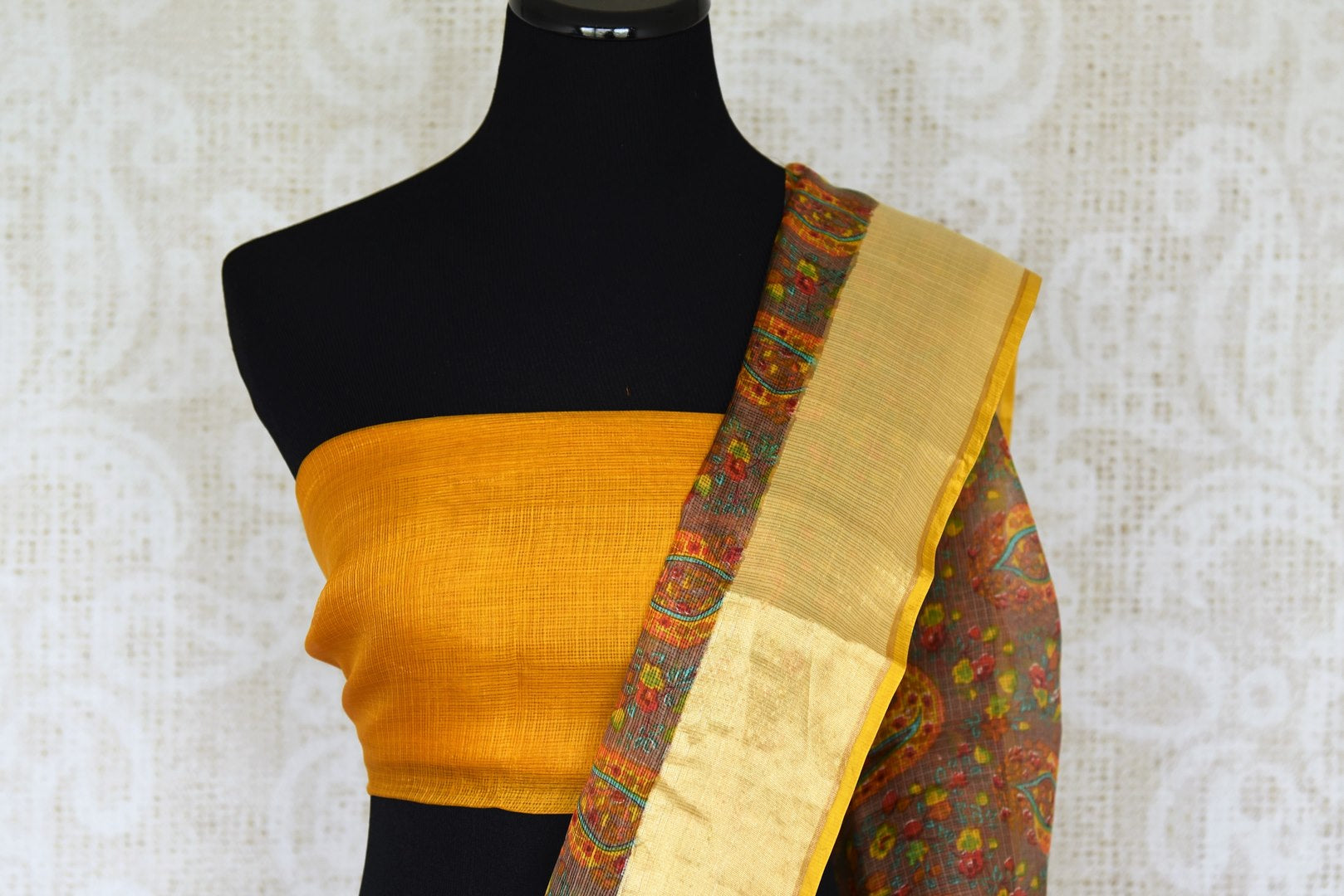 Invest in handcrafted authentic zari kota silk traditional sari this season to look your best. This yellow colored traditional saree with handprinted motifs and zari border is every woman's must-have. Shop designer silk sarees, kanjeevaram silk sarees, handloom saris online or visit Pure Elegance store in USA.-blouse pallu