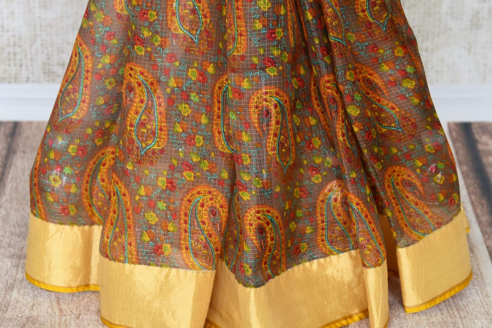 Invest in handcrafted authentic zari kota silk traditional sari this season to look your best. This yellow colored traditional saree with handprinted motifs and zari border is every woman's must-have. Shop designer silk sarees, kanjeevaram silk sarees, handloom saris online or visit Pure Elegance store in USA.-pleats