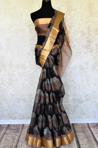 Gorgeous motifs printed on the facade of this black kota silk saree is drool-worthy. The spectacular gold border on border and brown blouse is work of art. You cannot go wrong in this Lord Buddha printed kota silk sari to work.Shop handloom sarees, ikkat saris, printed sarees online or visit Pure Elegance store, USA. -full view
