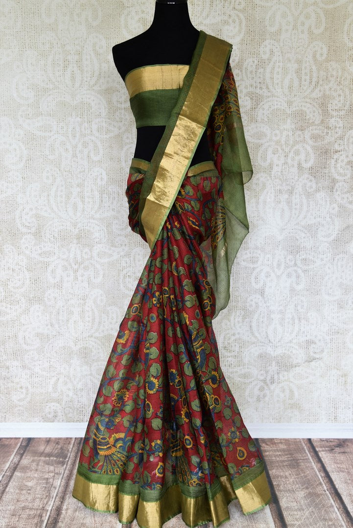 Enchanting red zari kota silk saree made of 100% silk is your answer to parties and occasional wear. Drape this gorgeous red colored silk sari with a contrasting green and zari border blouse. Shop handloom sarees, banarsi silk sarees, designer silk saris online or visit Pure Elegance store in USA. -full view