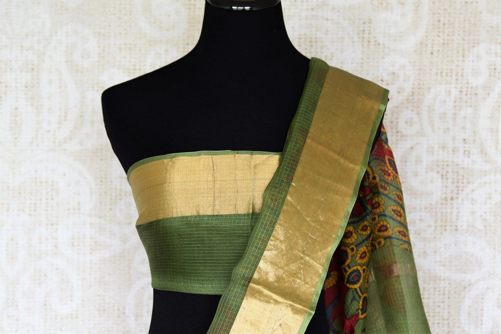 Enchanting red zari kota silk saree made of 100% silk is your answer to parties and occasional wear. Drape this gorgeous red colored silk sari with a contrasting green and zari border blouse. Shop handloom sarees, banarsi silk sarees, designer silk saris online or visit Pure Elegance store in USA. -blouse pallu