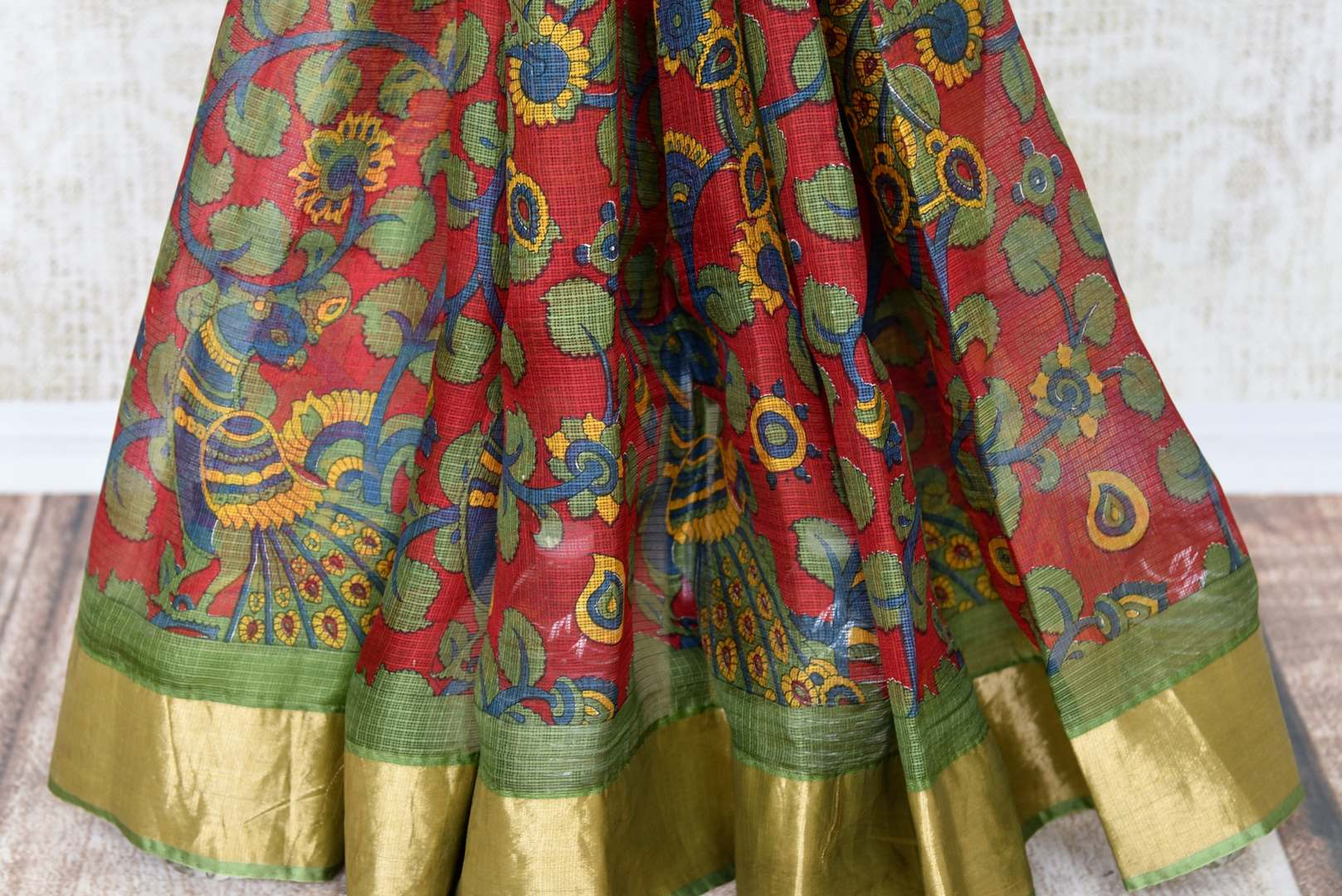 Enchanting red zari kota silk saree made of 100% silk is your answer to parties and occasional wear. Drape this gorgeous red colored silk sari with a contrasting green and zari border blouse. Shop handloom sarees, banarsi silk sarees, designer silk saris online or visit Pure Elegance store in USA. -pleats