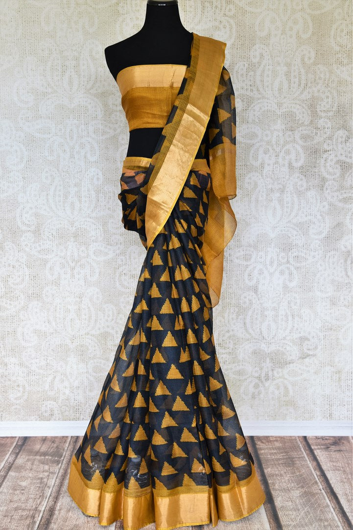 Stylish and fashionable, this black zari kota silk saree is all you need. Shop this beautifully handwoven zari kota sari complemented with a contrasting yellow zari border blouse to look elegant at evening parties. Shop handloom sarees, Indian designer silk saris, banarsi silk sarees online or visit Pure Elegance store in USA.-full view