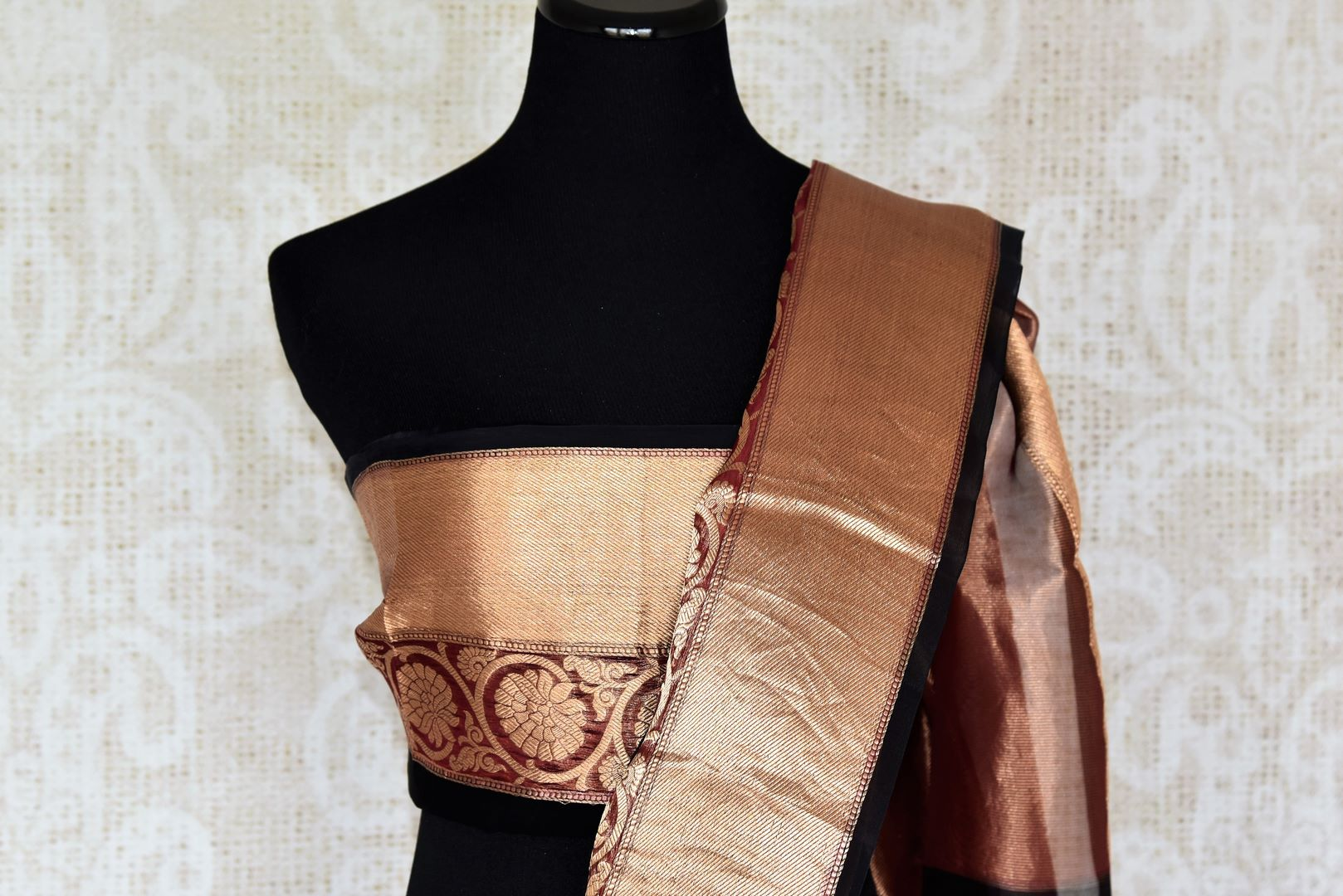 Dreaming hues of brown and gold blend in this organza maheshwari silk sari. Featuring a rich gold zari border with stunning check pattern all over the saree, this is a perfect bet for parties, weddings and events. Shop handcrafted silk sarees, chiffon sari, printed sari online or visit Pure Elegance store, USA.-blouse pallu