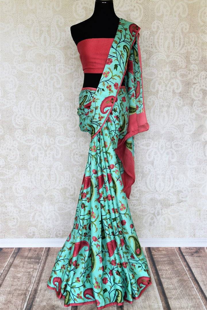 Buy elegant green crepe silk saree online in USA with floral print. Elevate your Indian style with an alluring collection of Indian designer sarees, silk saris available at Pure Elegance Indian fashion store in USA or shop online.-full view