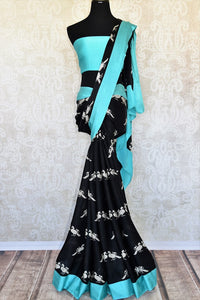Buy black printed crepe silk saree online in USA with blue border. Elevate your Indian style with an alluring collection of Indian designer sarees available at Pure Elegance Indian fashion store in USA or shop online.-full view