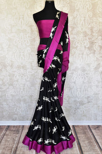 Buy black printed crepe silk sari online in USA with magenta border. Elevate your Indian style with an alluring collection of Indian designer sarees available at Pure Elegance Indian fashion store in USA or shop online.-full view