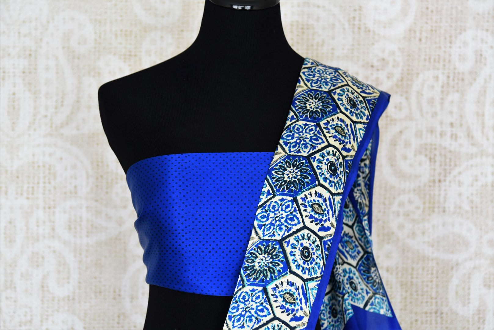 Shop blue printed crepe silk saree online in USA. Make your ethnic wardrobe rich with Indian designer sarees available at Pure Elegance exclusive clothing store in USA or shop online.-blouse pallu