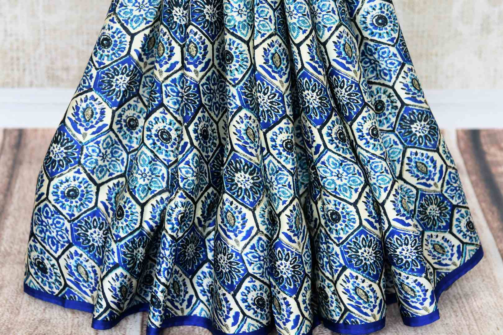 Shop blue printed crepe silk saree online in USA. Make your ethnic wardrobe rich with Indian designer sarees available at Pure Elegance exclusive clothing store in USA or shop online.-pleats