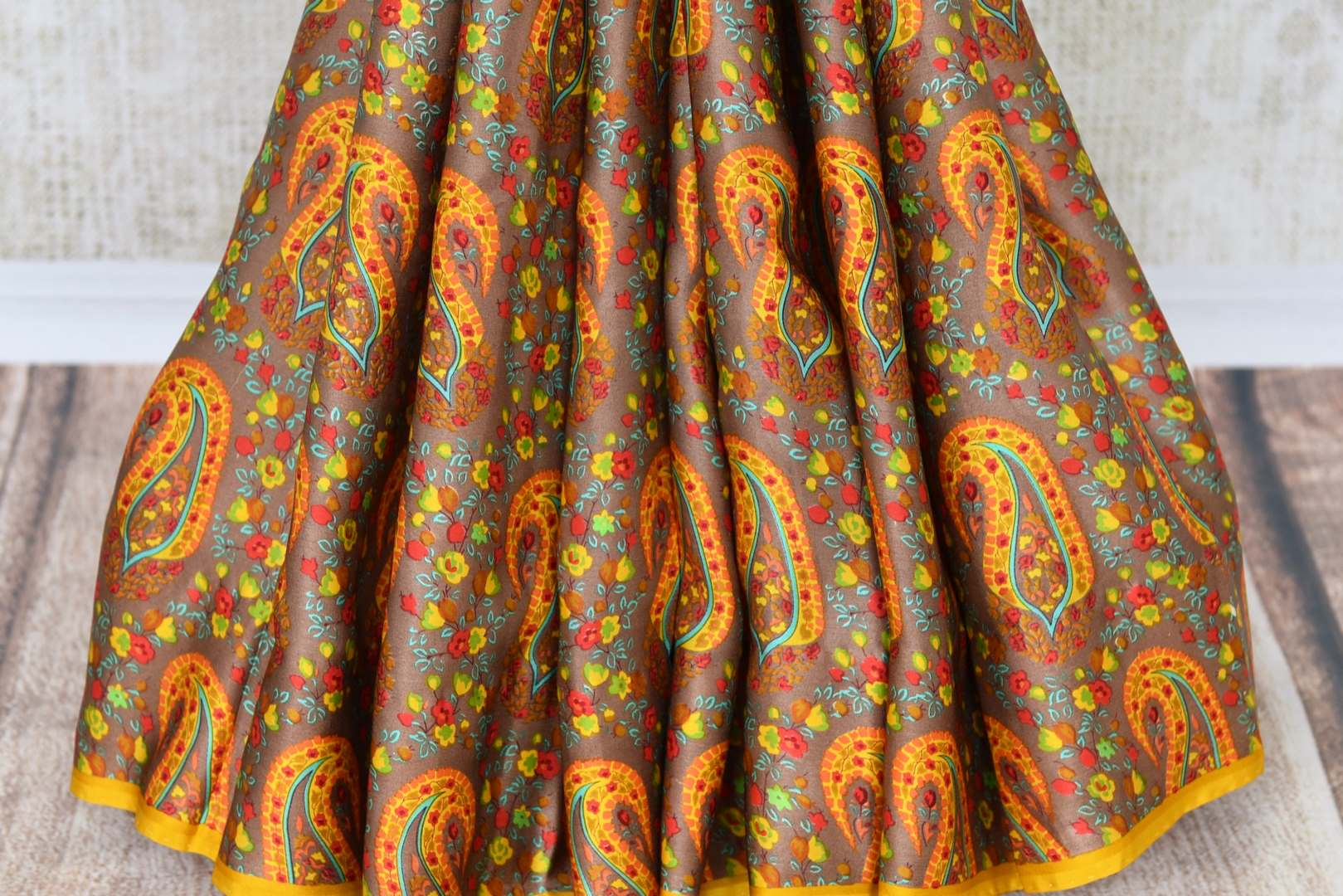 Shop brown printed crepe silk saree online in USA. Make your ethnic wardrobe rich with Indian designer saris available at Pure Elegance exclusive clothing store in USA or shop online.-pleats