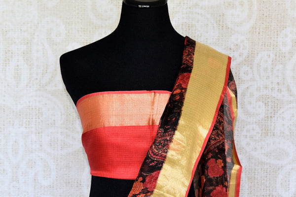 This designer black handprinted kota silk saree is every artistic woman's dream come true. This black and red-hued sari features traditional prints and a contrasting red with zari detailing blouse is spell-binding. Shop designer silk sarees, banarsi silk saris, ikkat sarees online or visit Pure Elegance store, USA. -blouse pallu