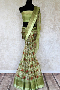 Uo your stylish quotient with our green zari kota silk floral hand printed sari. Run errands or show up at a family gathering in this beautiful silk saree. Pair matching green blouse to steal the show. Shop handloom sarees, Indian designer silk saris, banarsi sarees online or visit Pure Elegance store in USA. -full view