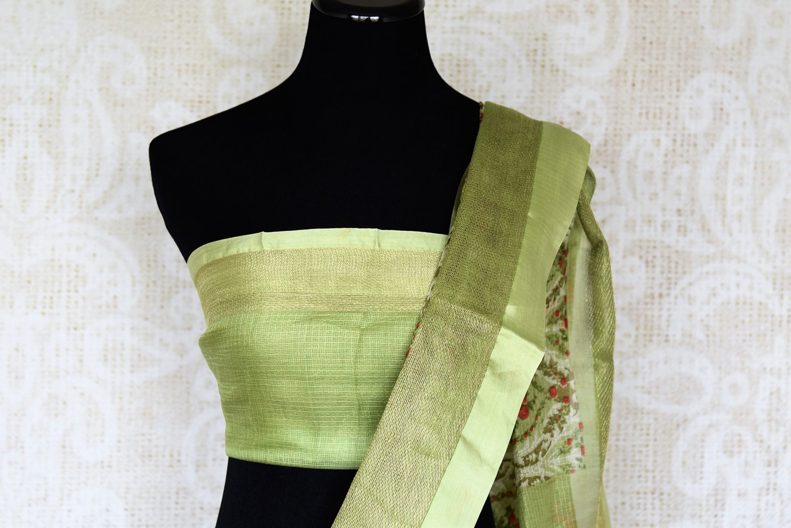 Uo your stylish quotient with our green zari kota silk floral hand printed sari. Run errands or show up at a family gathering in this beautiful silk saree. Pair matching green blouse to steal the show. Shop handloom sarees, Indian designer silk saris, banarsi sarees online or visit Pure Elegance store in USA. -blouse pallu