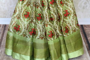 Uo your stylish quotient with our green zari kota silk floral hand printed sari. Run errands or show up at a family gathering in this beautiful silk saree. Pair matching green blouse to steal the show. Shop handloom sarees, Indian designer silk saris, banarsi sarees online or visit Pure Elegance store in USA. -pleats