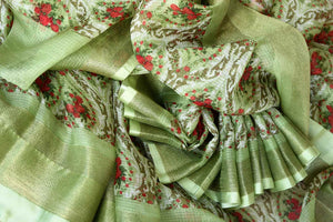 Uo your stylish quotient with our green zari kota silk floral hand printed sari. Run errands or show up at a family gathering in this beautiful silk saree. Pair matching green blouse to steal the show. Shop handloom sarees, Indian designer silk saris, banarsi sarees online or visit Pure Elegance store in USA. -details