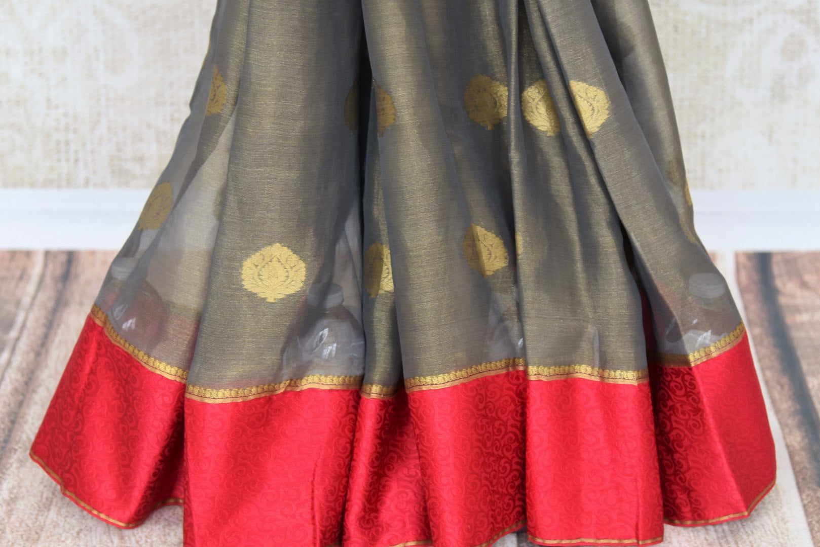 Shop grey tissue silk saree online in USA with red crepe border. Make your ethnic wardrobe rich with Indian designer saris available at Pure Elegance exclusive clothing store in USA or shop online.-pleats