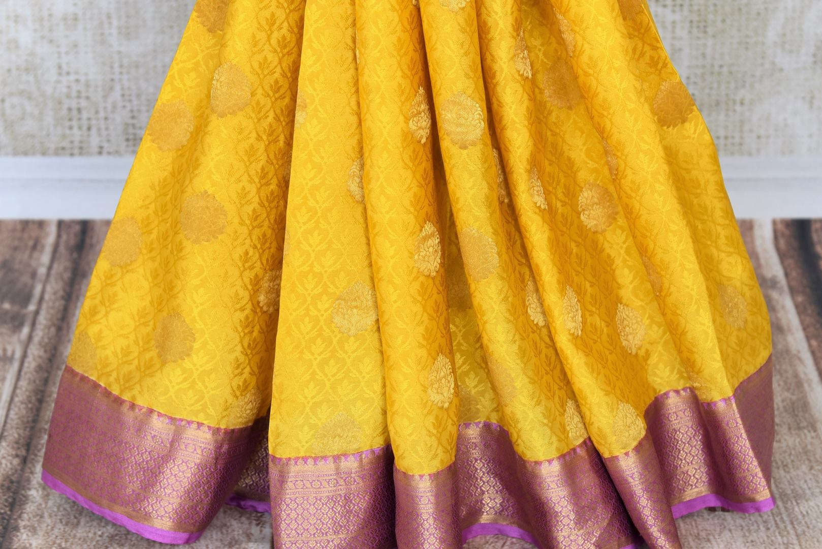 Buy yellow crepe silk sari online in USA with zari weave and buta. Make your ethnic wardrobe rich with Indian designer sarees available at Pure Elegance exclusive clothing store in USA or shop online.-pleats