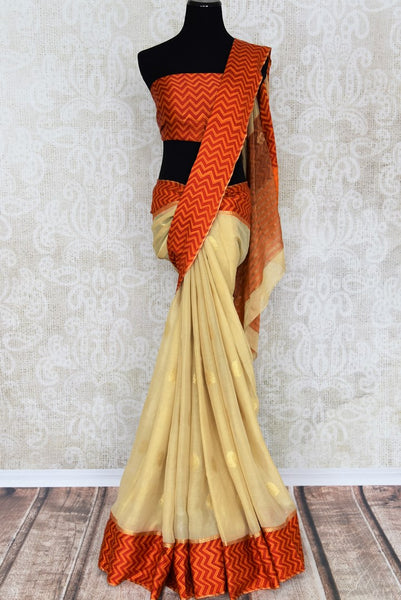 Buy elegant cream tissue silk sari online in USA with crepe border. Make your ethnic wardrobe rich with Indian designer sarees, silk sarees available at Pure Elegance exclusive clothing store in USA or shop online.-full view