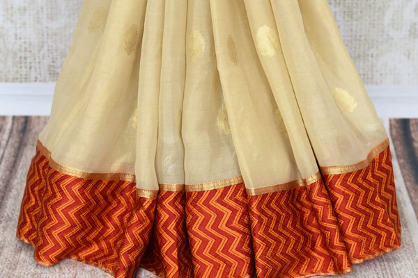 Buy elegant cream tissue silk sari online in USA with crepe border. Make your ethnic wardrobe rich with Indian designer sarees, silk sarees available at Pure Elegance exclusive clothing store in USA or shop online.-pleats