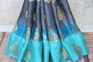 Buy alluring blue silk saree online in USA with zari weave and buta. Make your ethnic wardrobe rich with Indian designer sarees, silk sarees available at Pure Elegance exclusive clothing store in USA or shop online.-pleats
