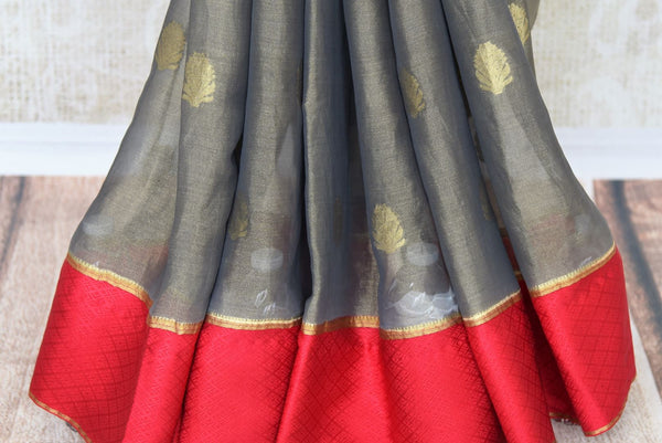 Shop dark grey tissue silk saree online in USA with red crepe border. Make your ethnic wardrobe rich with Indian designer silk saris available at Pure Elegance exclusive clothing store in USA or shop online.-pleats