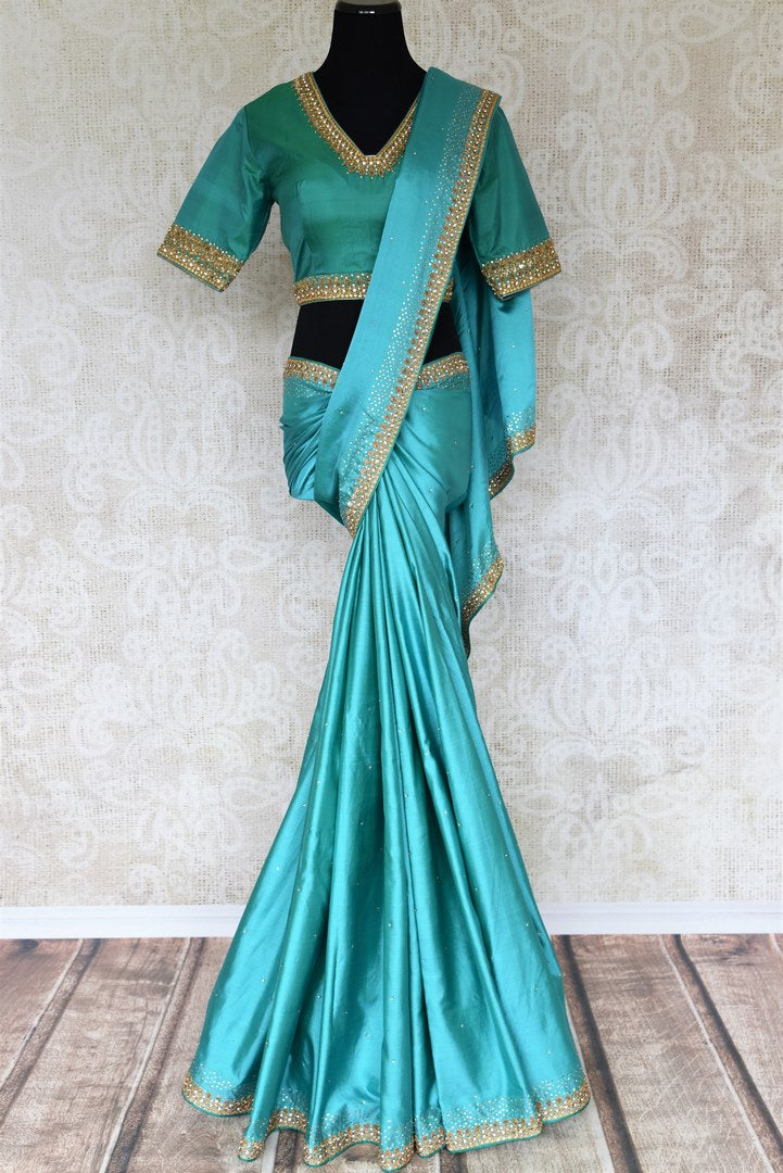 Shop beautiful blue pure silk saree online in USA with hand embroidery. The saree comes with a matching designer saree blouse. Make your Indian clothing collection exquisite with beautiful Indian designer sarees available at Pure Elegance clothing store in USA or shop online.-full view