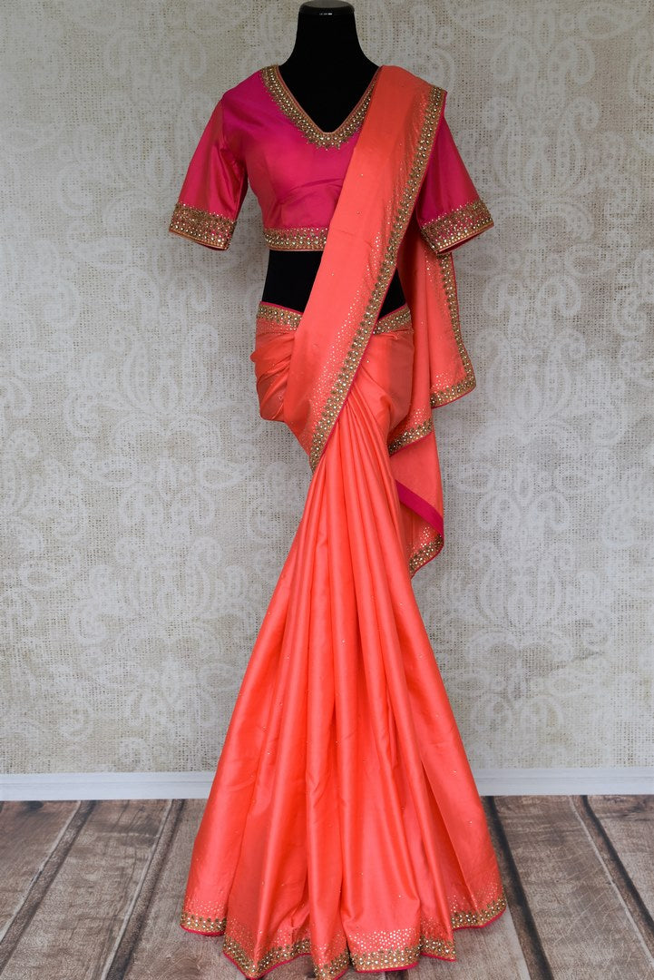 Buy beautiful orangish peach pure silk saree online in USA with hand embroidery. The saree comes with a pink designer saree blouse. Make your Indian clothing collection exquisite with beautiful Indian designer sarees, pure silk sarees available at Pure Elegance clothing store in USA or shop online.-full view