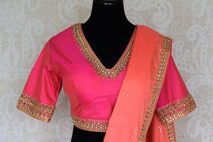 Buy beautiful orangish peach pure silk saree online in USA with hand embroidery. The saree comes with a pink designer saree blouse. Make your Indian clothing collection exquisite with beautiful Indian designer sarees, pure silk sarees available at Pure Elegance clothing store in USA or shop online.-blouse pallu
