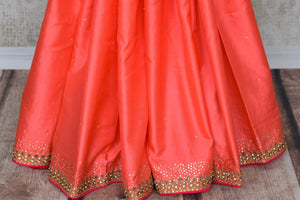 Buy beautiful orangish peach pure silk saree online in USA with hand embroidery. The saree comes with a pink designer saree blouse. Make your Indian clothing collection exquisite with beautiful Indian designer sarees, pure silk sarees available at Pure Elegance clothing store in USA or shop online.-pleats