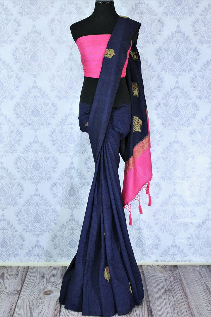 Dress up for weddings and special events in this royal blue designer muga banarsi silk sari with a stunning zari work. Style this glorious saree with a contrasting pink blouse complemented with a pink border on the heavily embroidered pallu to turn heads. Shop designer sarees online or visit Pure Elegance store in USA.-full view