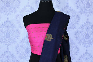 Dress up for weddings and special events in this royal blue designer muga banarsi silk sari with a stunning zari work. Style this glorious saree with a contrasting pink blouse complemented with a pink border on the heavily embroidered pallu to turn heads. Shop designer sarees online or visit Pure Elegance store in USA.-blouse pallu
