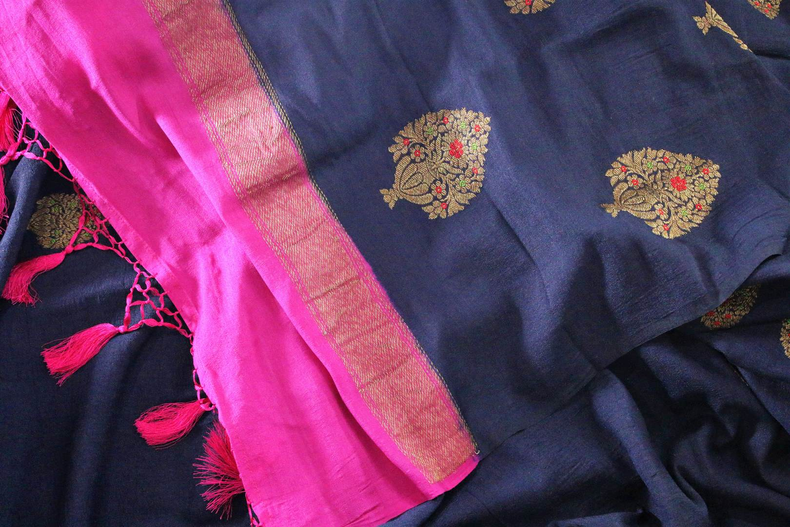 Dress up for weddings and special events in this royal blue designer muga banarsi silk sari with a stunning zari work. Style this glorious saree with a contrasting pink blouse complemented with a pink border on the heavily embroidered pallu to turn heads. Shop designer sarees online or visit Pure Elegance store in USA.-details