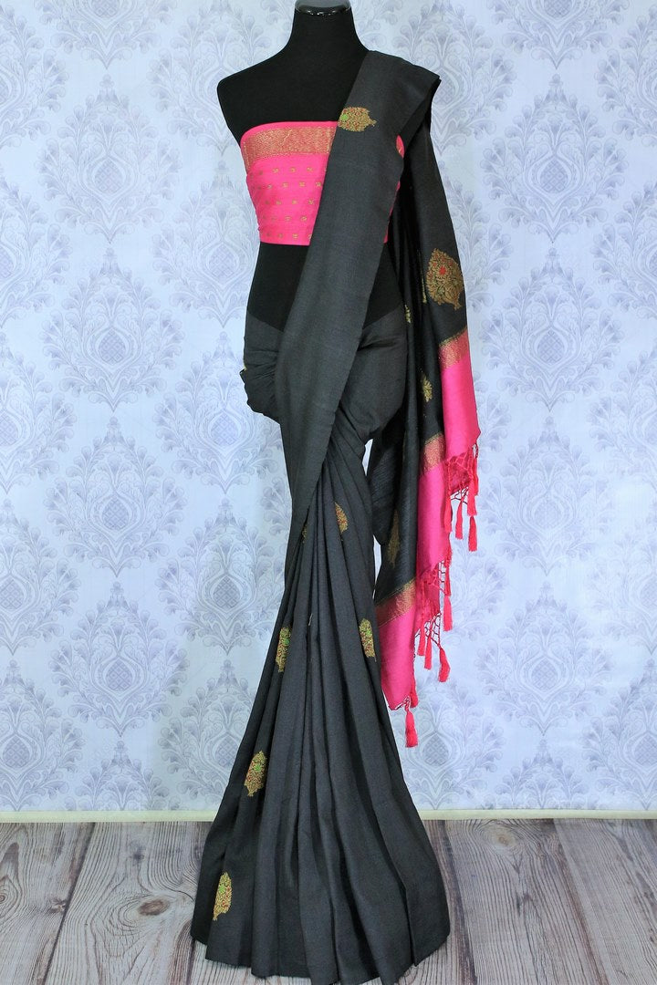 Slay effortlessly in this designer black muga banarsi silk designer sari with a gorgeous blend of zari embroidery. Style this astonishing saree with a contrasting pink zari silk blouse complemented with a rich embroidered pallu. Shop designer silk sarees online or visit Pure Elegance store in USA.-full view