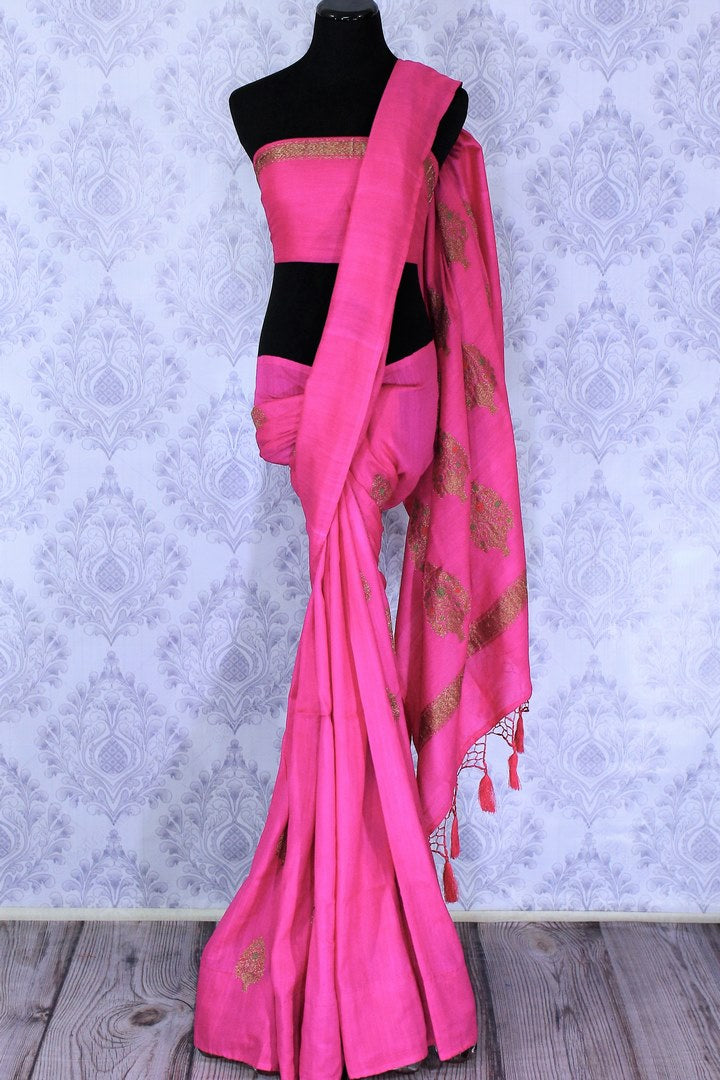 Be the showstopper in this exquisitely designed bright pink embroidered muga banarsi silk sari with zari detailing. Style this vibrant sari with a magenta blouse and  the heavily embroidered pallu for weddings or parties. Shop printed silk sarees, crepe silk saris, ikkat sarees online or visit Pure Elegance store in USA. -full view