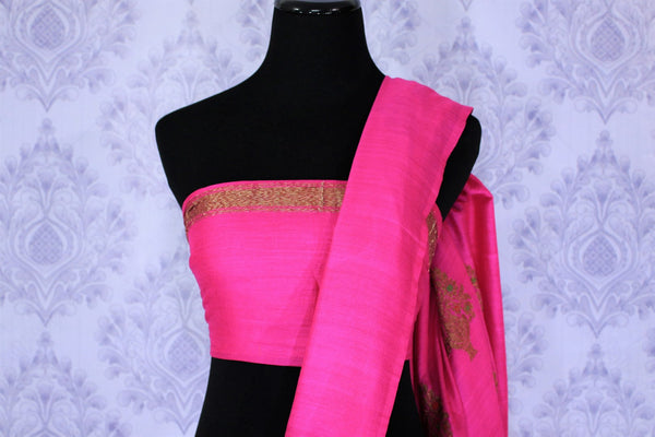 Be the showstopper in this exquisitely designed magenta embroidered muga banarsi silk sari with zari detailing. Style this vibrant sari with a magenta blouse and  the heavily embroidered pallu for weddings or parties. Shop printed silk sarees, crepe silk saris, ikkat sarees online or visit Pure Elegance store in USA. -blouse pallu