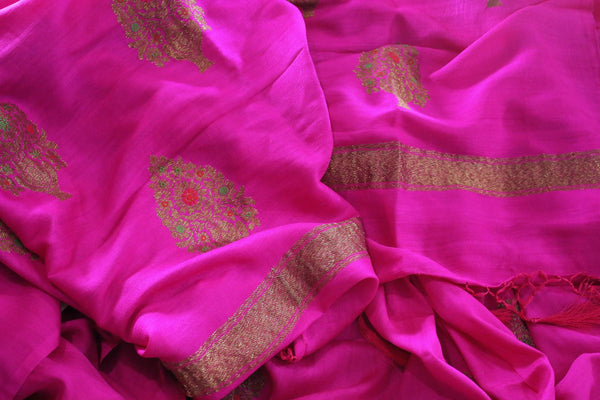 Be the showstopper in this exquisitely designed magenta embroidered muga banarsi silk sari with zari detailing. Style this vibrant sari with a magenta blouse and  the heavily embroidered pallu for weddings or parties. Shop printed silk sarees, crepe silk saris, ikkat sarees online or visit Pure Elegance store in USA. -details