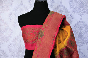 Your perfect wedding ensemble in traditional yellow and red combination with zari detailing is oh so dreamy. Indulge in this breath-taking muga banarsi silk saree complemented with a heavy woven red pallu and designer red blouse. Shop designer silk sarees, ikkat sarees online or visit Pure Elegance store in USA.-blouse pallu