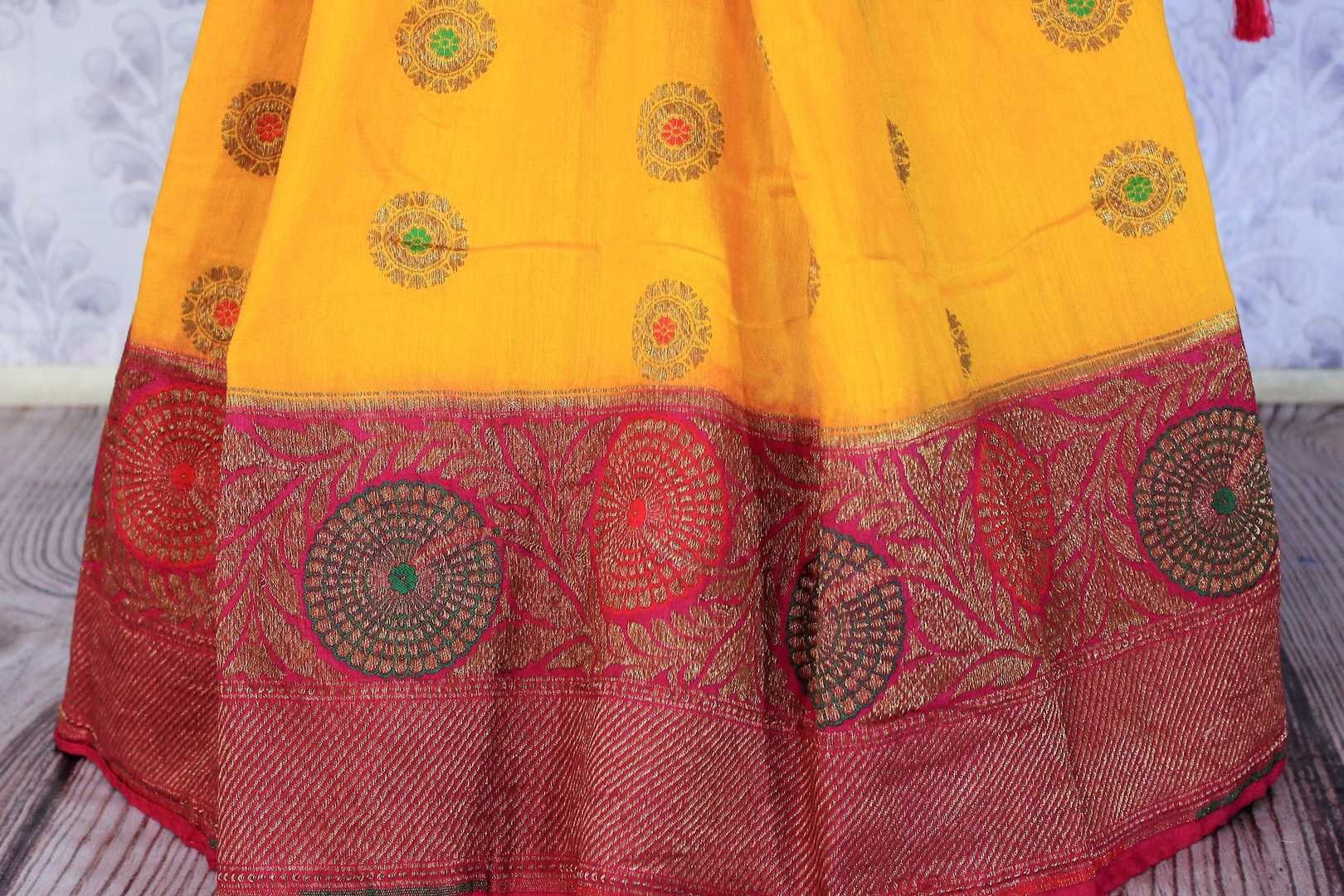 Your perfect wedding ensemble in traditional yellow and red combination with zari detailing is oh so dreamy. Indulge in this breath-taking muga banarsi silk saree complemented with a heavy woven red pallu and designer red blouse. Shop designer silk sarees, ikkat sarees online or visit Pure Elegance store in USA.-pleats