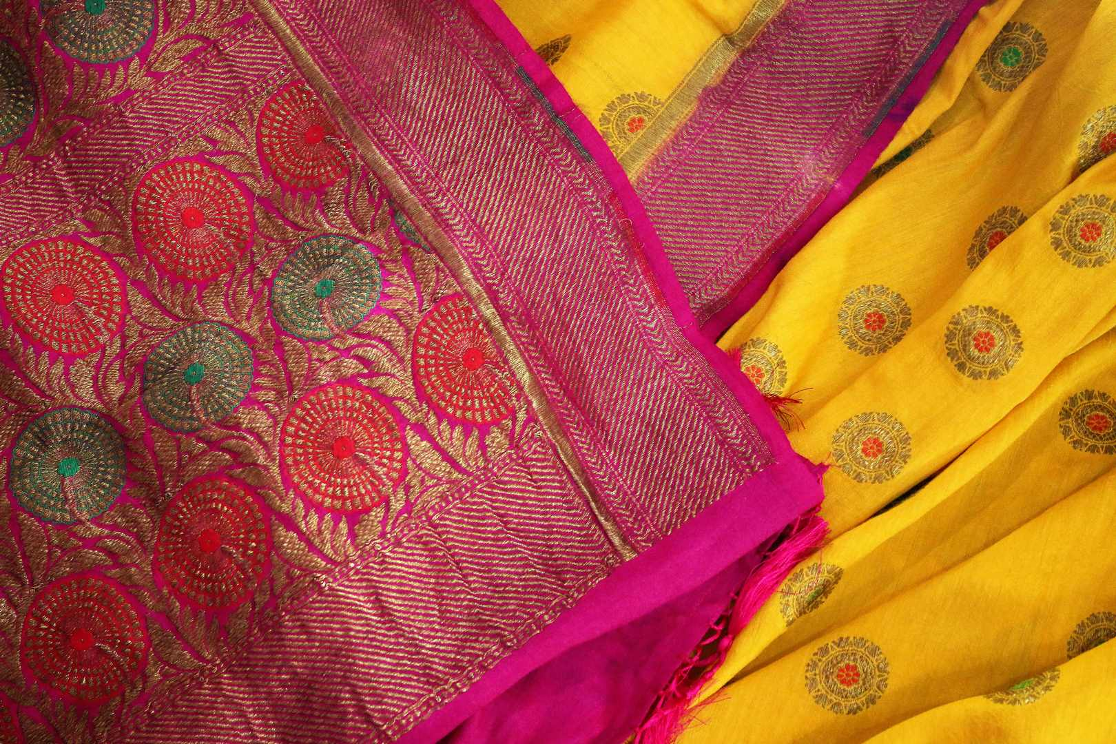 Your perfect wedding ensemble in traditional yellow and red combination with zari detailing is oh so dreamy. Indulge in this breath-taking muga banarsi silk saree complemented with a heavy woven red pallu and designer red blouse. Shop designer silk sarees, ikkat sarees online or visit Pure Elegance store in USA.-details