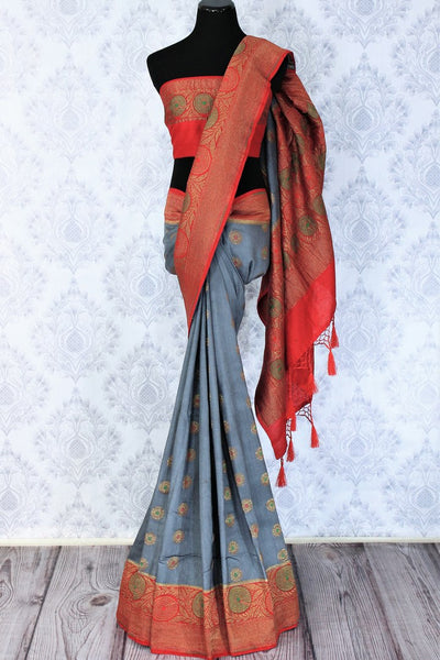 Relish the exquisite wedding ensemble with this grey and red combination of muga banarsi silk saree. The zari border complemented with a stunning red embroidered designer blouse and a heavily woven red zari pallu is such an eye-catcher. Shop designer silk saris,printed sarees online or visit Pure Elegance store in USA.-full view