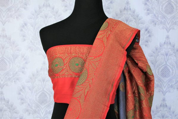 Relish the exquisite wedding ensemble with this grey and red combination of muga banarsi silk saree. The zari border complemented with a stunning red embroidered designer blouse and a heavily woven red zari pallu is such an eye-catcher. Shop designer silk saris,printed sarees online or visit Pure Elegance store in USA.-blouse pallu