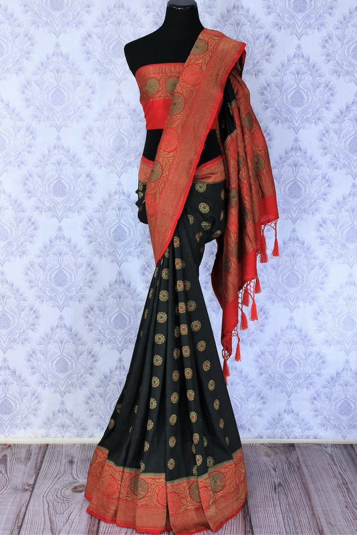 A classic black and red silk saree with buta work and zari border is totally in vogue. Style this designer muga banarsi silk saree with a red embroidered blouse and get ready to be poured with compliments galore. Shop designer silk sarees, kalamkari sarees, Indian dress online or visit Pure Elegance store in USA.-full view