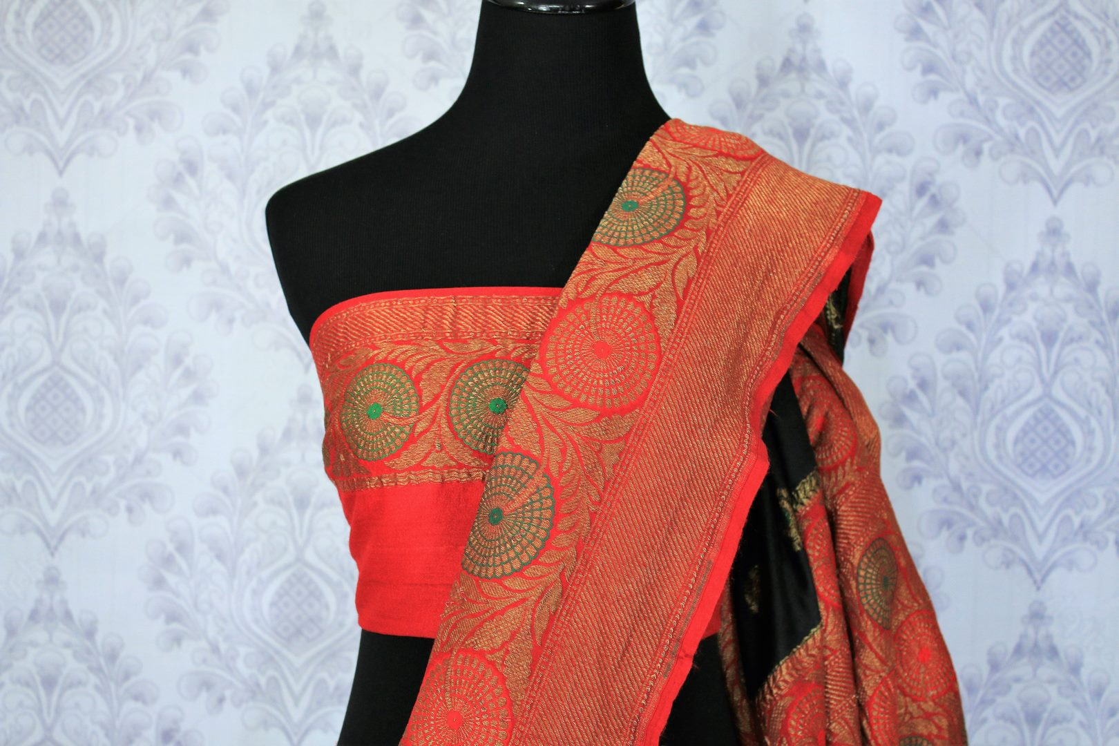A classic black and red silk saree with buta work and zari border is totally in vogue. Style this designer muga banarsi silk saree with a red embroidered blouse and get ready to be poured with compliments galore. Shop designer silk sarees, kalamkari sarees, Indian dress online or visit Pure Elegance store in USA.-blouse pallu