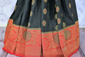 A classic black and red silk saree with buta work and zari border is totally in vogue. Style this designer muga banarsi silk saree with a red embroidered blouse and get ready to be poured with compliments galore. Shop designer silk sarees, kalamkari sarees, Indian dress online or visit Pure Elegance store in USA.-pleats