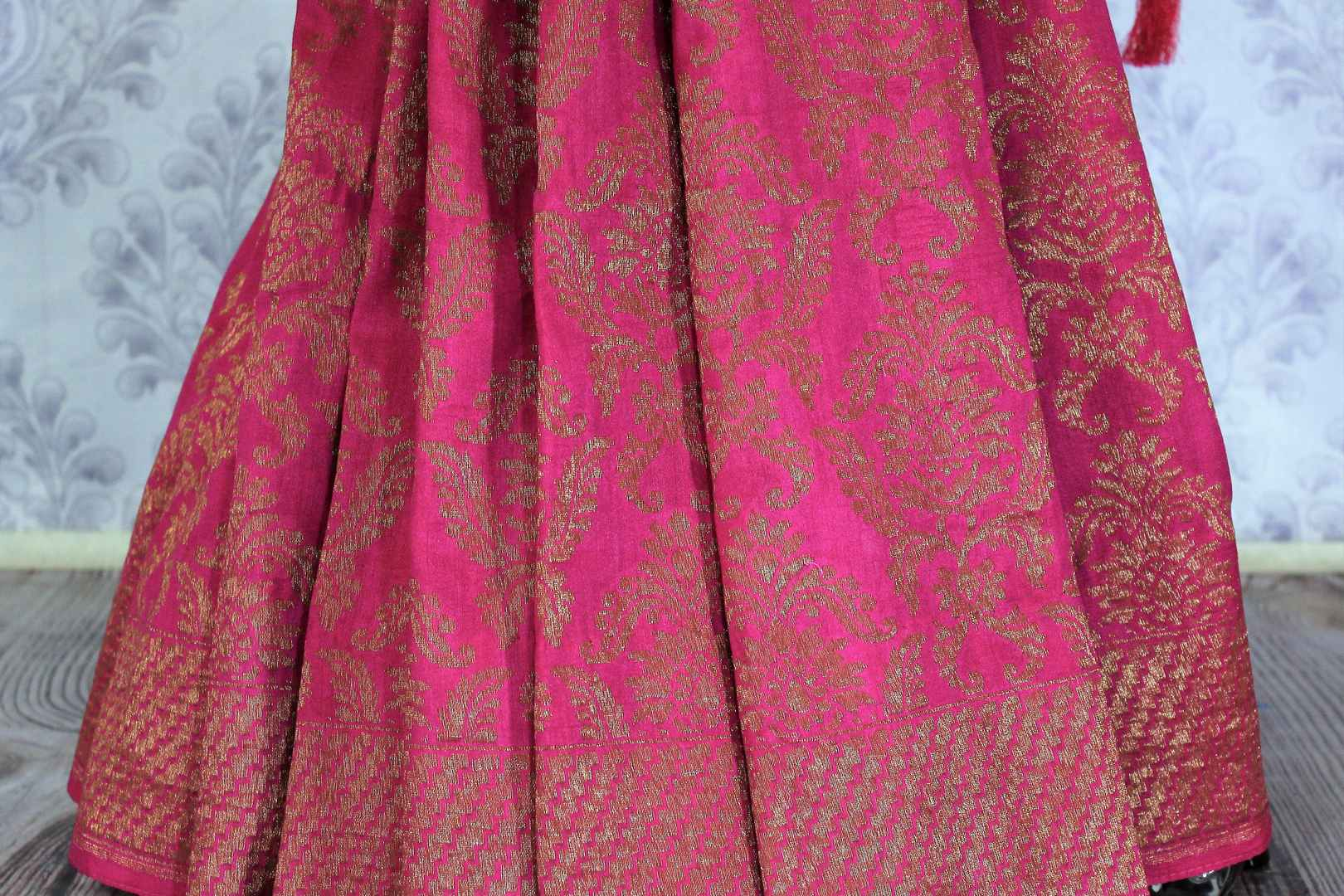 Drape this exclusively designed red and pink half-half designer muga banarsi silk saree. The intricate floral embroidery with zari detailing on border and pallu is unparalleled. Style it with a pink zari detailing blouse. Shop designer sarees, printed saris, banarsi silk saris online or visit Pure Elegance store in USA-pleats
