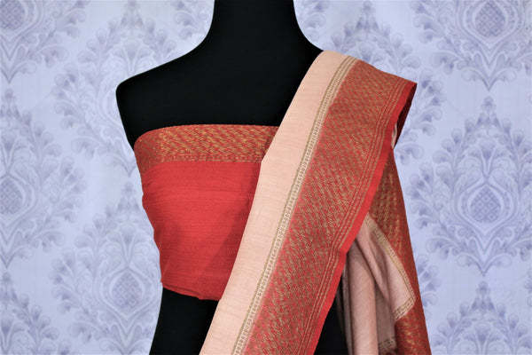 Sashay in this designer half-half muga banarsi silk sari to weddings, parties and festivities with panache. Style this red with beige signature Indian saree with a deep red embroidered blouse to strike a lasting impression. Shop designer silk sarees, printed saris, ikkat sarees online or visit Pure Elegance store in USA. -blouse pallu