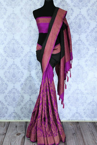 Indulge in this classic black and purple floral embroidered muga banarsi silk sari with a hint of zari work on the border and pallu. Style this designer half-half saree with a contrasting purple embroidered blouse. Shop designer silk sarees, printed sarees, ikkat saris online or visit Pure Elegance store in USA. -full view
