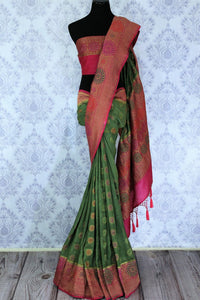 This astonishingly beautiful green embroidered muga banarsi silk saree looks effortlessly charming for weddings and events. Style this designer half-half silk sari with a red zari embroidered blouse. Shop designer silk sarees, printed saris, ikkat sarees online or visit Pure Elegance store in USA. -full view